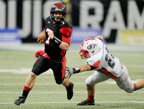 Globe | T. Rob Brown<br /> Lamar's Levi Peterson keeps just ahead of the reach of Lawson's Joshua Sutphin Friday evening, Nov. 29, 2013, during the Show-Me Bowl at the Edward Jones Dome in St. Louis.
