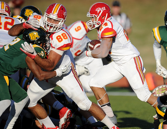 Globe/Roger Nomer<br /> Pittsburg State's Kyle Swartz puts a block on Missouri Southern's Patrick Cheek to clear the way for Keynan Scheurich (24) to score on Saturday at Fred G. Hughes Stadium.