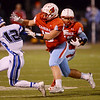 Globe/Roger Nomer<br /> Webb City's Terrell Kabala runs off a block from Channing Mickey on Harrisonville's Nick Laughlin during Friday's game in Webb City.