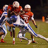 Globe/Roger Nomer<br /> Webb City's Durand Henderson is tackled by Harrisonville's Joe Snooks during Friday's game in Webb City.