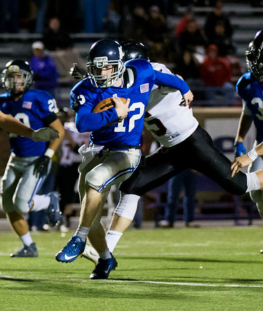 Globe|Israel Perez<br /> Colgan's Billy Dickey (12) gains yardage against Washington Co. during their Class 2-1A quarter final game on Friday night, November 11th, 2016 at Hutchinson Field in Pittsburg KS.