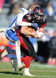 Lamar's Danny Embry drags Lafayette's Mason Haynes during the Tigers state semifinal game on Saturday at Lamar. Globe | Laurie Sisk