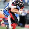 Lamar's Danny Embry drags Lafayette's Mason Haynes during the Tigers state semifinal game on Saturday at Lamar.<br /> Globe | Laurie Sisk