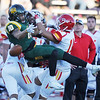 Globe/Roger Nomer<br /> Missouri Southern's Jordan Morrison collides with Pittsburg State's Matt Magee (35) and Darian Taylor (11) to draw a pass interference call on Saturday at Fred G. Hughes Stadium.