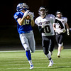 Globe|Israel Perez<br /> Colgan's Jeremiah Buche (16) makes the catch beating Jacob Latta (10) of Washington Co. during their Class 2-1A quarter final game on Friday night, November 11th, 2016 at Hutchinson Field in Pittsburg KS.
