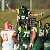 Globe/Roger Nomer<br /> Missouri Southern's Jordan Morrison (10) is lifted up by teammate Jarrell Jackson (75) after scoring against Pittsburg State on Saturday at Fred G. Hughes Stadium.