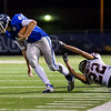 Globe|Israel Perez<br /> Colgan's Josh Hayes (44) beats the tackle of Ka'Shaun Vernon (22) of Washington Co. during their Class 2-1A quarter final game on Friday night, November 11th, 2016 at Hutchinson Field in Pittsburg KS.