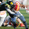 Globe/Roger Nomer<br /> Missouri Southern's Idrissa Simpson tackles Pittsburg State's Dre Holman during Saturday's game at Fred G. Hughes Stadium.
