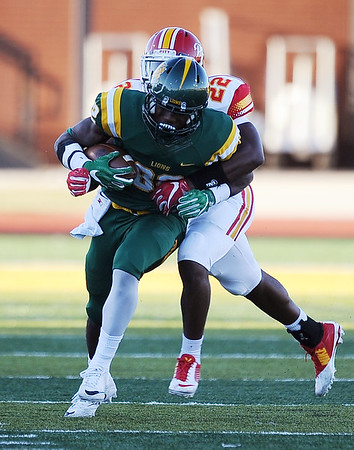 Globe/Roger Nomer<br /> Pittsburg State's	Deron Washington tackles Missouri Southern's Jocqui Davis during Saturday's game at Fred G. Hughes Stadium.