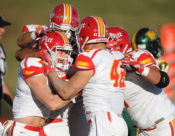 Globe/Roger Nomer<br /> Pittsburg State's Ramsey Hamilton, left, is mobbed by teammates after scoring in the first quarter against Missouri Southern on Saturday at Fred G. Hughes Stadium.