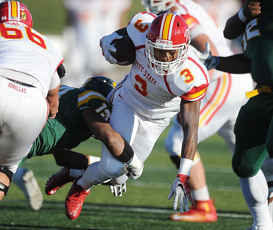 Globe/Roger Nomer<br /> Missouri Southern's Romel Hill tackles Pittsburg State's Kiah Kintchen during Saturday's game at Fred G. Hughes Stadium.