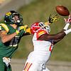 Globe/Roger Nomer<br /> Missouri Southern's Anthony Cannon reaches out to prevent an interception by Pittsburg State's Darrius White during Saturday's game at Fred G. Hughes Stadium.