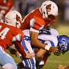 Globe/Roger Nomer<br /> Webb City's Blaise Williams (24) and Javis Berlin tackle Harrisonville's Cabren Yoder during Friday's game in Webb City.