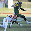 Globe/Roger Nomer<br /> Missouri Southern's Brayden Scott leaps over a tackle from Pittsburg State's Darrius White during Saturday's game at Fred G. Hughes Stadium.