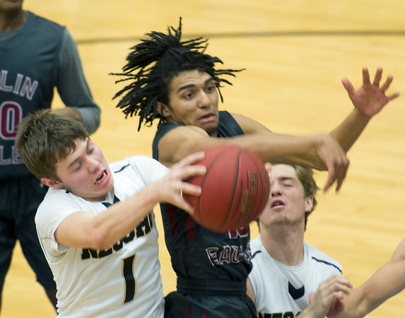 Neosho's Connor Johnson (1) battles Joplin's Malaki Love for a rebound during their semifinal game of the Carthage High School Invitational on Friday night at CHS.<br /> Globe | Laurie Sisk