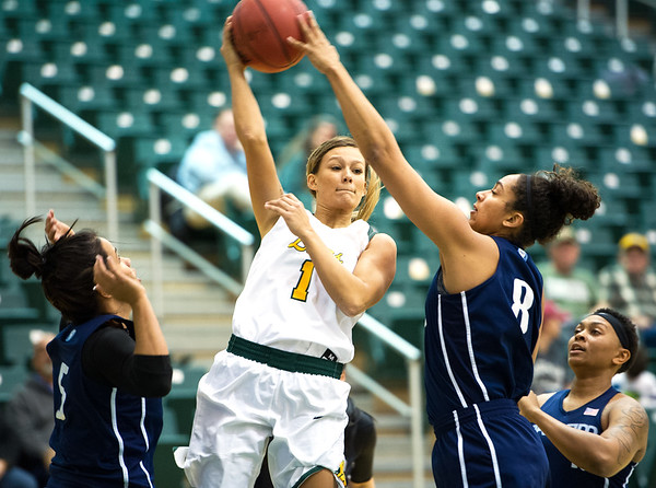 Missouri Southern's Dru Clark (1) dishes off to a teammate as Livin' The Dream's Sanayika Shields (8) defends during their exhibition game on Tuesday night at Leggett & Platt. Also pictured are former MSSU players Camila Lacerda, left, and Tee Singleton.<br /> Globe   Laurie Sisk