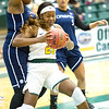 Missouri Southern's Azaria Reed (20) battles Livin' The Dream's Shonte Clay as Camila Lacerda (5) looks on during their exhibition game on Tuesday night at Leggett & Platt. Clay and Lacerda are both former MSSU players.<br /> Globe | Laurie Sisk