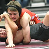 Webb City's Kyler Carter (top) battles Carl Junction's Kynden Bennett during their 106-lb match on Thursday night at JHS.<br /> Globe | Laurie Sisk