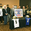 Representatives from Independence Community College, left, and Northeastern Oklahoma A&M pose for a group photo during a press conference announcing that they will play each other in the Midwest Classic Bowl on Dec. 3 in Miami.<br /> Globe | Laurie Sisk