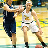 Missouri Southern's Jensen Maydew (31) drives the lane as Livin' The Dream's Lauren Meyers (3) defends during their exhibition game on Tuesday night at Leggett & Platt.