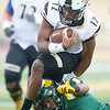Missouri Southern's Devonte Thomas (5) brings down Lindenwood quarterback Najee Jackson (12) with a touchdown-saving tackle during their game on Saaturday at Fred G. Hughes Stadium.<br /> Globe  Laurie Sisk