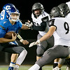 Globe|Israel Perez<br /> Zeke Sappington (4) of Carthage runs the ball as he tries to get around Aaron Schuerger (9) of Willard during the district final on Friday night at David Haffner Stadium in Carthage.