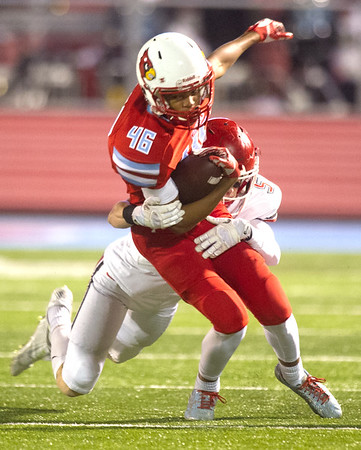 Carl Junction's Tyler White (5) tries to bring down Webb City runningback Devron Weathers (46) during their playoff game on Friday night at Webb City.<br /> Globe | Laurie Sisk