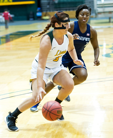 Missouri Southern's Julianna Wadsworth (3) dribbles toward the basket as Livin' The Dream's Sarah Magana (11) defends during their exhibition game on Tuesday night at Leggett & Platt.<br /> Globe | Laurie Sisk