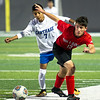 Carthage midfielder Victor Cancinos-Lopez (7) and Carl Junction midfielder Hayden Wilson (12) race for the ball during their match on Tuesday night at Carthage.<br /> Globe | Laurie Sisk