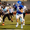 Colgan's Max Wilson runs the ball for a first down past Lyndon's Jaden Hielscher(7) and Gunnar Markham(58) in Friday night's game against Lyndon at Carnie Smith Stadium in Pittsburg.