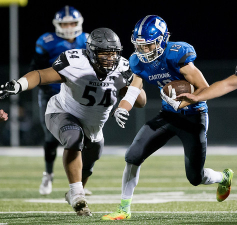 Globe|Israel Perez<br /> Corben Pugh (13) of Carthage runs the ball for a gain of yards as Tommy Tapia of Willard goes after Pugh for a tackle  during the district final on Friday night at David Haffner Stadium in Carthage.