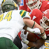 Pittsburg State runningback D'Vontae Brown (32) tries to get past Missouri Southern linebcker Roc Robbins (44) during their game on Saturday at Pittsburg.<br /> Globe | Laurie Sisk