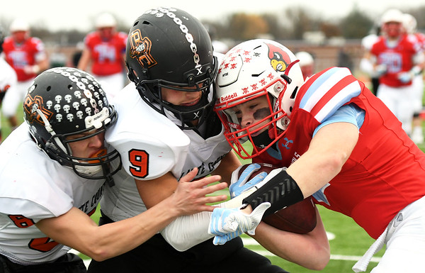 Webb City's Alex Gaskill, right, tries to get past Platte County's Hunter Tongate (8) and Dylan Gilbert (9) during their Class 4 semifinal game on Saturday at Webb City.<br /> Globe | Laurie Sisk