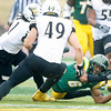 Missouri Southern's Eric Dedrick, Jr. (6) twists his body as he tries to catch a low thrown ball as Lindenwood's Monte Hamlet (21) and Nate Blanchard (49) close in during their game on Saturday at Fred G. Hughes Stadium.<br /> Globe  Laurie Sisk