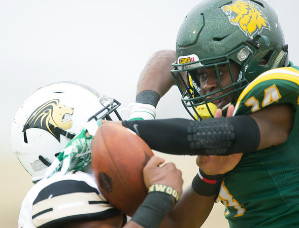 Missouri Southern's Keith Beverly, right, breaks up a pass in the endzone intended for Lindenwood's Grady Daniels during their game on Saturday at Fred G. Hughes Stadium.<br /> Globe  Laurie Sisk