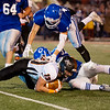 Lydon's Dexton Swinehart is brought down for a loss by Colgan's Jeremiah Buche(16) and Matthew Lomshek(33) in Friday night's game in Pittsburg.