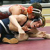 Joplin's Brayden Williams (bottom) works to escape the grasp of Reed Springs' Cayden Love during their 145-lb match on Thursday night at JHS.<br /> Globe | Laurie Sisk