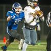Carthage defensive end Mason Bryant (89) closes in on Columbia Battle quarterback Jaren Lewis (5) during their quarterfinal game on Friday night at Carthage.<br /> Globe | Laurie Sisk