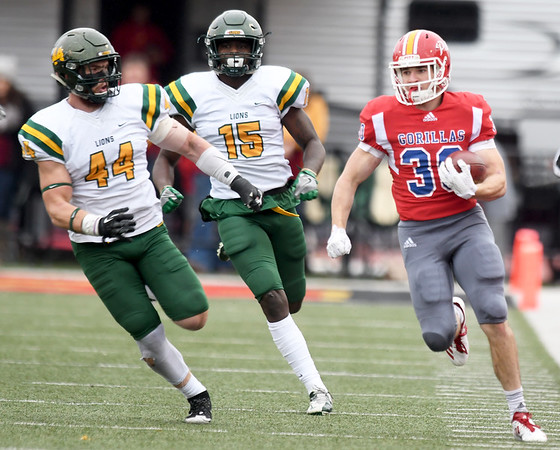 Pittsburg State runningback Michael Rose (30) runs for a long gain as Missouri Southern's Roc Robbins (44) and E.J. McKenzie (15) give chase during their game on Saturday at Pittsburg.<br /> Globe | Laurie Sisk