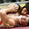 Joplin's Bobby Owens (top) works to pin Reed Springs' Briar Crain during their 138-lb match on Thursday night at JHS.<br /> Globe | Laurie Sisk