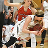 Carl Junction's xx xx (11) ties up Neosho's Tori Frazier (3) during their championship game of the CJ Classic on Thursday night at CJHS.<br /> Globe | Laurie Sisk