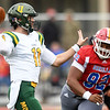Pittsburg State's Simanu'a Thomas (92) pressures Missouri Southern quarterback Brayden Scott (11) during their game on Saturday at Pittsburg.<br /> Globe | Laurie Sisk