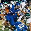 Globe/Roger Nomer<br /> Commerce's Chris Ibarra runs for a gain against the Adair defense during Friday's game in Commerce.
