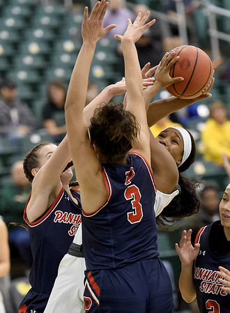 Missouri Southern's Destiny Cozart (1) splits Panhandle State defenders Hannah Faulks, left, and Kim Best (3) during their game on Tuesday night at Leggett & Platt.<br /> Globe | Laurie Sisk