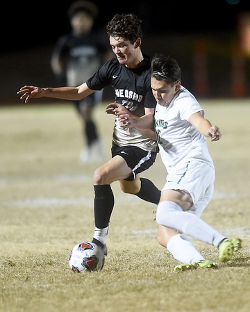 From the left: Neosho's Dylan Collins battles Parkview's Antonio Rubio during their sectional match on Tuesday night at NHS.<br /> Globe | Laurie Sisk