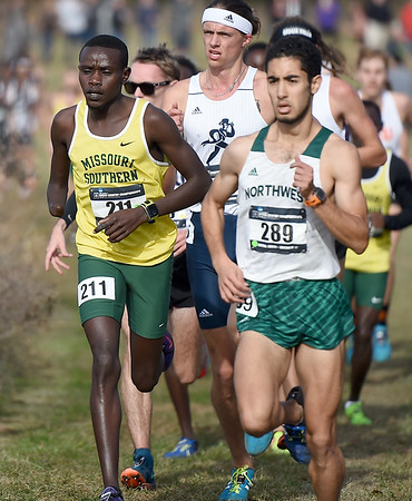 Missouri Southern's Gidieon Kimutai (211) tries to pass Northwest's Karim Achengli (289) during the Central Region Cross Country Championships on Saturday at MSSU.<br /> Globe   Laurie Sisk