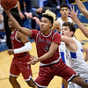 Joplin's James Moman (4) gets past Carthage's Christian Talamantez during their game on Tuesday night at Carthage.<br /> Globe | Laurie Sisk