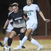 Neosho's Brayden Johnson (8) battles Parkview'sChance Levings (25) during their sectional match on Tuesday night at NHS.<br /> Globe | Laurie Sisk
