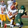 Pittsburg State's William Bazzle intercepts a pass intended for Missouri Southern's Cole Dunbar (89) during their game on Saturday at Fred G. Hughes Stadium. Also pictured is Pitt State's Paul Davis (16).<br /> Globe | Laurie Sisk