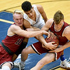 Joplin's Blake Tash (12) and Alex Crawford, left, battle Carthage's Taris Jackson for a loose ball during their game on Tuesday night at Carthage.<br /> Globe | Laurie Sisk